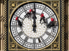 Workers cleaning Big Ben clock face