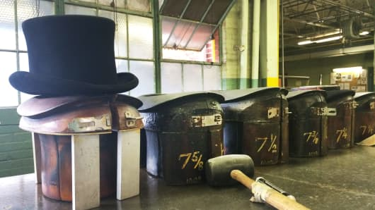 Collapsible molds used to size top hats. This decades-old, labor-intensive blocking technique is still used today.
