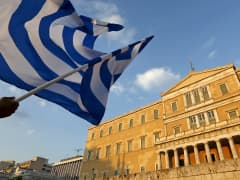 Protester waving Greek flag