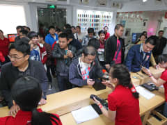 Customers wait in line to buy the Xiaomi Mi Note Pro