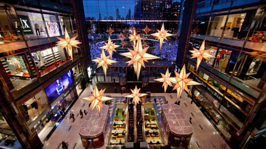 Holiday decorations are displayed inside The Shops at Columbus Circle at the Time Warner Center in New York.