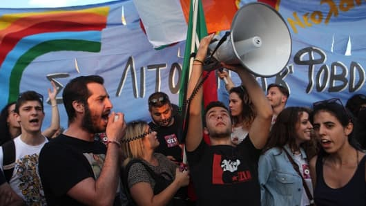 People hold a demonstration calling for Greece's exit from the euro zone in Athens, Greece.