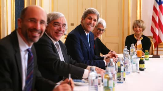 From left, US National Security Council Senior Director for Iran, Iraq, Syria and the Gulf States Robert Malley, US Secretary of Energy Ernest Moniz, US Secretary of State John Kerry and U.S. Under Secretary for Political Affairs Wendy Sherman attend the Iran nuclear talks at a hotel in Vienna, Austria on June 30, 2015.