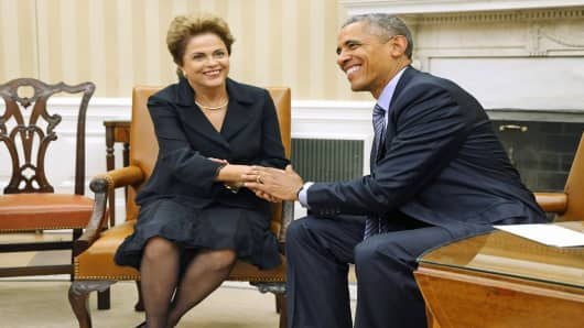 U.S. President Barack Obama shakes hands with Brazilian President Dilma Rousseff in the Oval Office of the White House in Washington, June 30, 2015.
