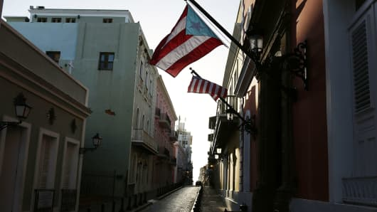 A Puerto Rican flag flies from a building in San Juan, Puerto Rico.