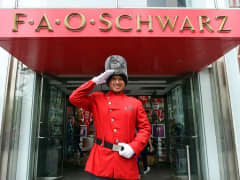 Employee dressed as toy soldier outside FAO Schwarz
