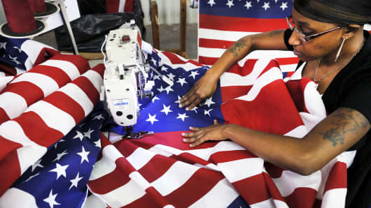 Keisha Hardman cuts and sews U.S. flags at Valley Forge's manufacturing facility in Lane, South Carolina June 23, 2015.