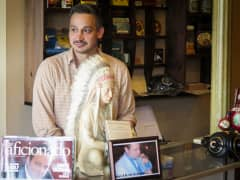 Randy Flores at work in his family's cigar shop, Havana on the Hudson.