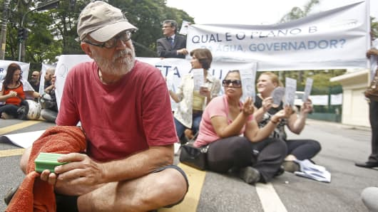 People protest the lack of water in the city while in front of the governmental palace in Sao Paulo.