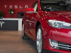 A Model S electric vehicle (EV) is displayed inside the show room at the Tesla Motors Inc. Gallery and Service Center in Paramus, New Jersey