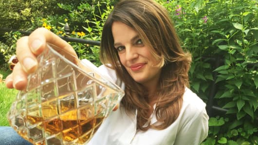 "Heather Greene, whiskey sommelier and author of ""Whisk(e)y Distilled: A Populist Guide to the Water of Life"" in Van Vorst Park in Jersey City."
