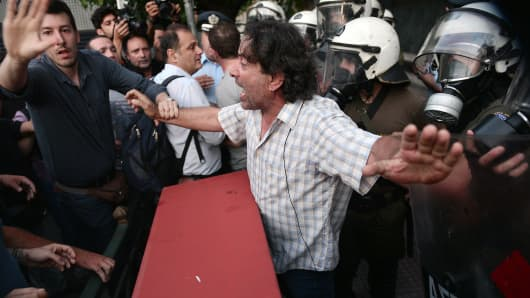 Anti-EU protesters scuffle with police outside the European Commission offices in Athens, Greece.