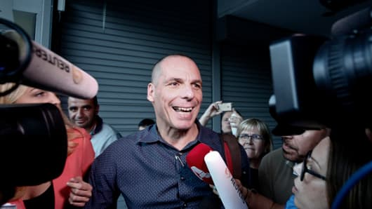Yanis Varoufakis, Greece's finance minister, speaks to the media as he leaves the finance ministry in Athens, Greece, on Wednesday, July 1, 2015.