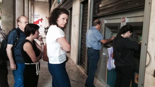 Greeks lined up to withdraw money at an ATM ahead of the referendum vote on Sunday July 5th.