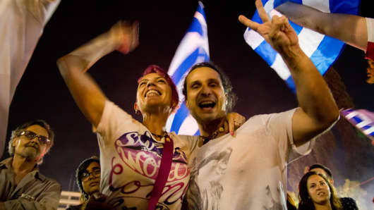 "Supporters of the ""no"" referendum vote celebrated in Syntagma Square in central Athens on Sunday."