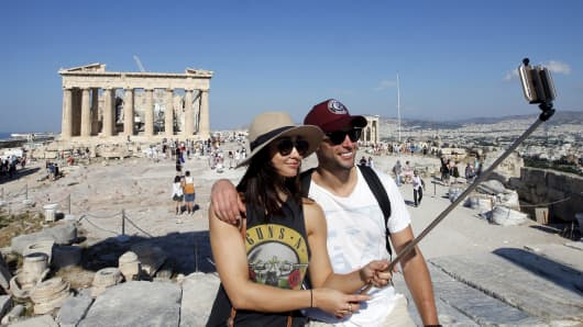 Tourists in front of the temple of the Parthenon atop the Acropolis, in Athens, last week.
