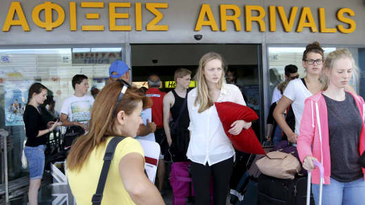 Tourists arrive at the airport on the island of Crete, Greece, July 6, 2015.