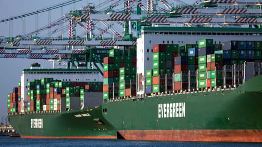 Cranes load and unload shipping containers from the Evergreen Ever Smile and Ever Learned ships at the Port of Los Angeles.