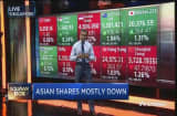 Asian shares mostly down