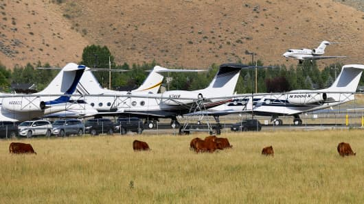 A private jet lands at the Sun Valley airport, joining dozens of other private and corporate jets already parked there, in Hailey, Idaho.
