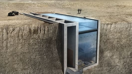 A proposed house built into a cliff above the Aegean Sea.