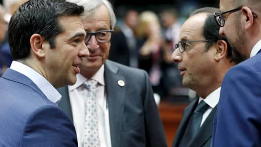 (L-R) Greece's Prime Minister Alexis Tsipras, European Commission President Jean-Claude Juncker, France's President Francois Hollande and Belgium's Prime Minister Charles Michel attend an euro zone leaders summit in Brussels, Belgium, July 12, 2015.