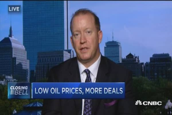 Low oil prices, more deals