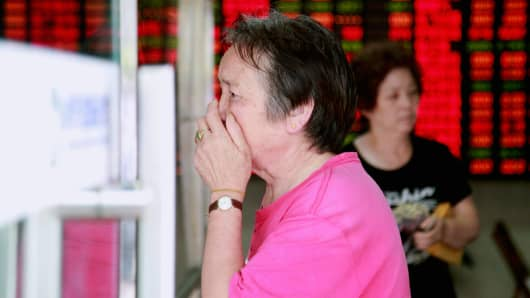 An investor reacts inside a brokerage firm on July 8, 2015 in Shanghai, China.