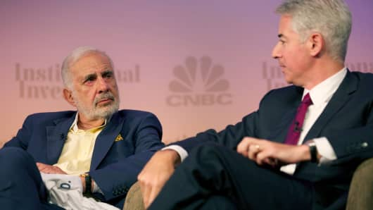 Activist investors Carl Icahn and Bill Ackman at the 2014 Delivering Alpha conference in New York.