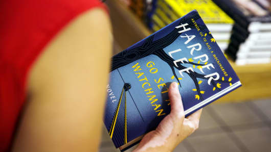 "A woman holds a copy of Harper Lee's book ""Go Set a Watchman"" before purchasing it inside of a Barnes & Noble store in New York, July 14, 2015."