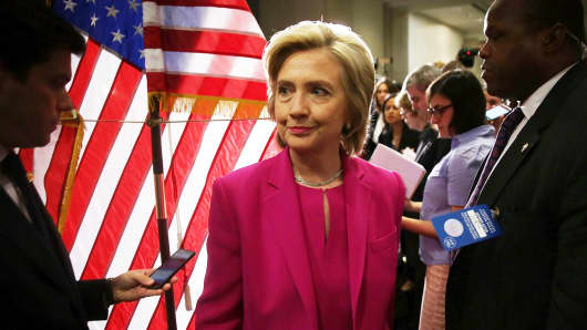 Democratic U.S. presidential hopeful and former U.S. Secretary of State Hillary Clinton leaves the podium after she spoke to members of the media July 14, 2015 on Capitol Hill in Washington.