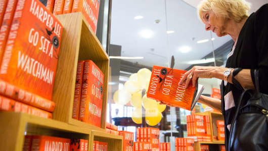 "A customer browses a copy of author Harper Lee's novel ""Go Set a Watchman"" at a bookstore in London, July 14, 2015."