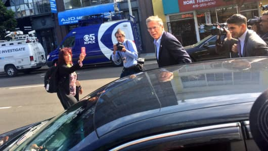 Jeb Bush exits an Uber car outside Thumbtack headquarters in San Francisco on July 16, 2015.