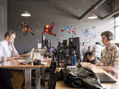 Employees of jet.com work and comics super heroes characters are seen on the wall at jet.com headquarter on Apr. 28, 2015 in Montclair, NJ.