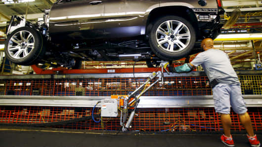 An employee works on the assembly line at the General Motors Assembly Plant in Arlington, Texas.