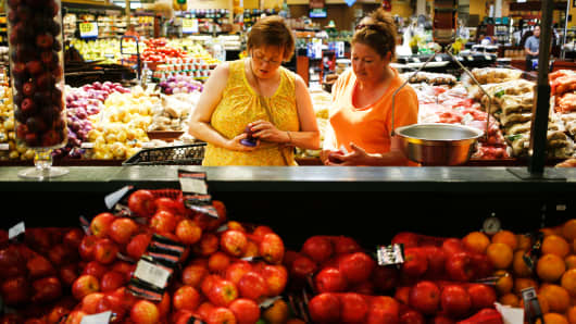 Customers shop the produce aisle at a Kroger grocery store in Louisville, Kentucky.