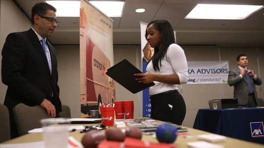 A job seeker meets with a recruiter during a HireLive career fair in San Francisco.
