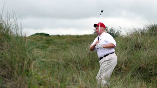 Donald Trump plays a round of golf after the opening of The Trump International Golf Links Course in Balmedie, Scotland.