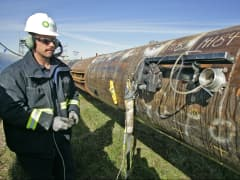 BP employee scanning oil pipeline section