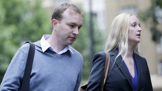Thomas 'Tom' Hayes, 35, a former trader at banks including UBS Group AG and Citigroup Inc., left, and his wife Sarah, arrive for his trial at Southwark Crown Court in London, U.K., on Friday, July, 24, 2015.