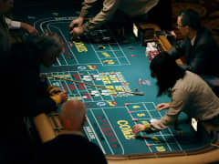 Patrons play craps at a table at Mohegan Sun in Uncasville, Conn. (file photo).