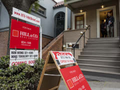 Potential home buyers exit a home for sale in the Castro district of San Francisco, California.