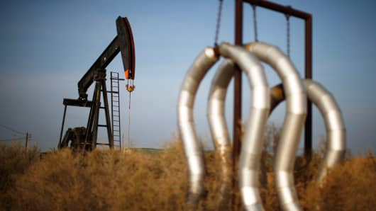 A pump jack and pipes at an oil field near Bakersfield, California.