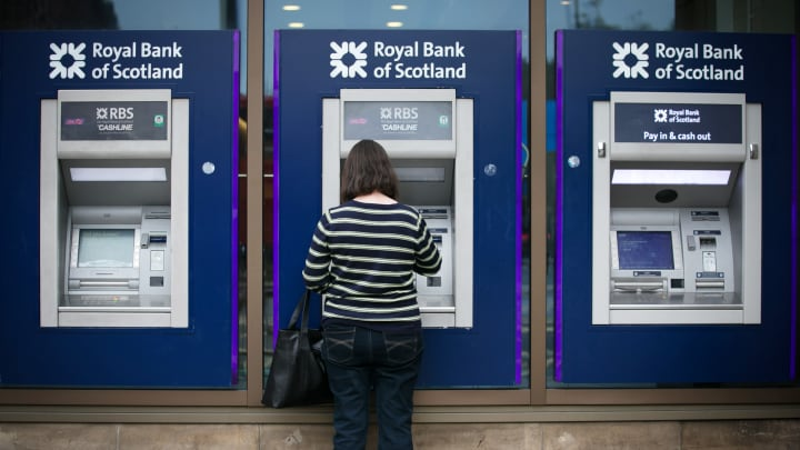 ATM cash machines outside a branch of the Royal Bank of Scotland in Edinburgh.