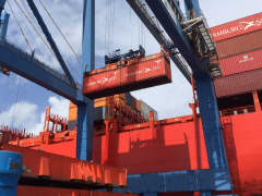 A shipping container is loaded at the Port of Charleston, South Carolina.