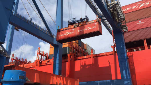 A shipping container is loaded at the Port of Charleston, S.C.