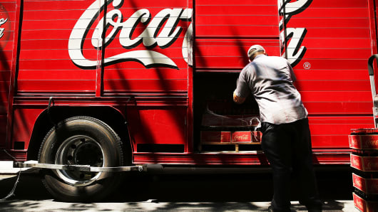 A man delivers beverages from a Coca-Cola truck in New York City.