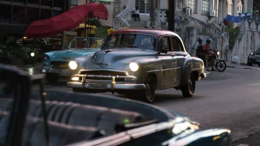 American cars cruise the streets of Havana.