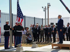 Secretary of State John Kerry (R) watches as Marines raise the American flag at the U.S. Embassy August 14, 2015 in Havana, Cuba.
