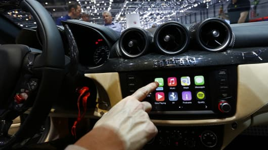 Apple Inc.'s CarPlay system is seen in the touchscreen console. Apple's Project Titan plans to test self-driving car at a secret location around San Francisco.